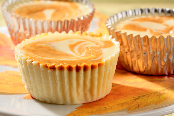 Individual swirled pumpkin cheesecakes