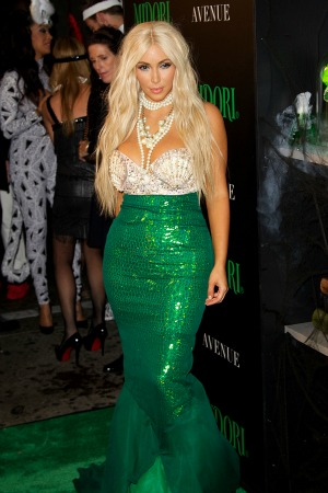 she hits the Midori party as a mermaid