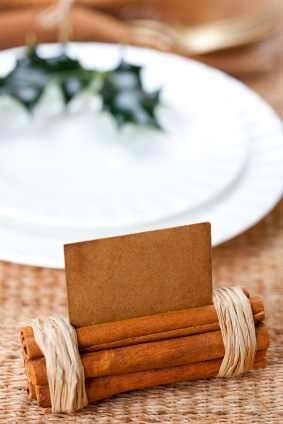 Cinnamon sticks wrapped with twine -- place holder card