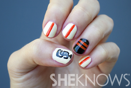 Round Nail Designs http://www.sheknows.com/beauty-and-style/articles/975245/san-francisco-giants-inspired-nail-design