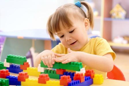 preschooler playing with blocks
