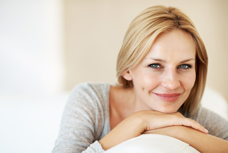 Smiling woman on couch