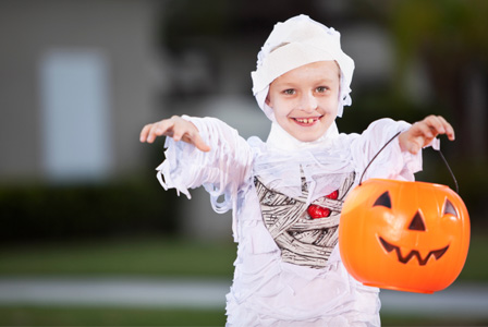 Little boy dressed as mummy on Halloween