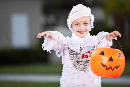 Little boy dressed as mummy on Halloween