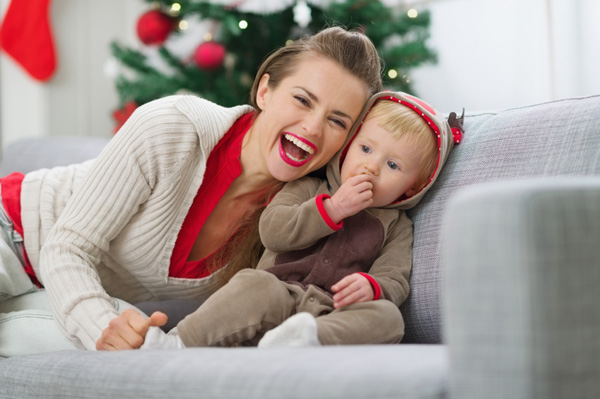 Mother with baby boy eating cookie on Christmas