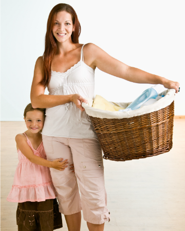 woman holding basket of clean laundry