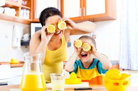 Mother and son laughing making lemonade