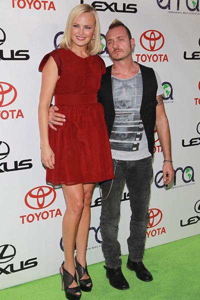 Pregnant Malin Akerman and her husband
