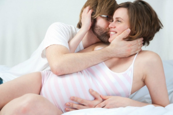 Pregnant couple cuddling