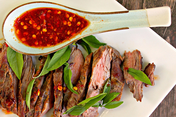 Grilled skirt steak with Thai red chili sauce and Thai basil