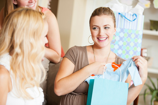 Woman receiving gifts at baby shower
