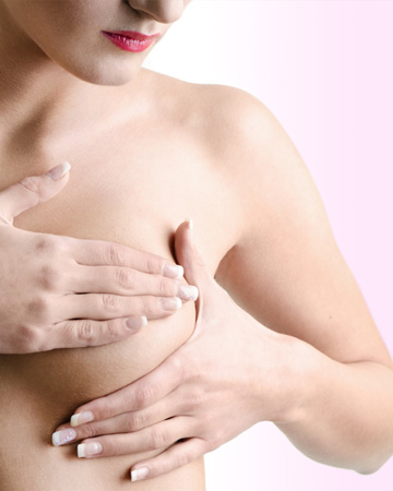 Woman doing self-breast exam