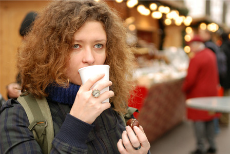 Woman eating at Christmas market