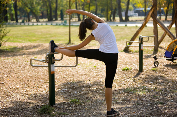 mom exercising at playground