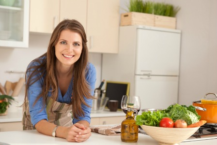 woman in a clean kitchen with dinner prepared
