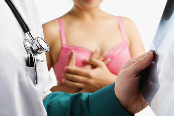 Woman wearing bra in doctor's office
