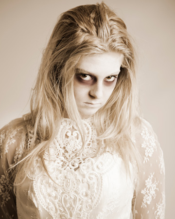 Woman wearing ghost makeup