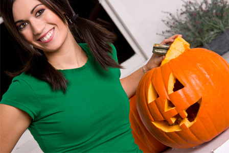 woman with carved pumpkin