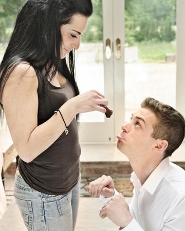 Woman making man beg