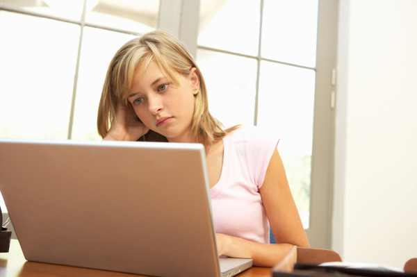 Worried teen girl on computer