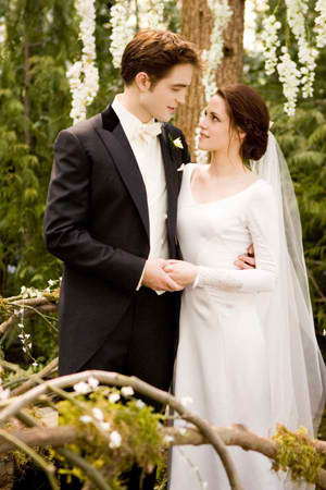 Robert Pattinson and Kristen Stewart as Edward and Bella in Breaking Dawn Wedding Scene