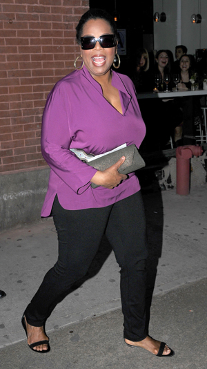 Oprah leaves a restaurant