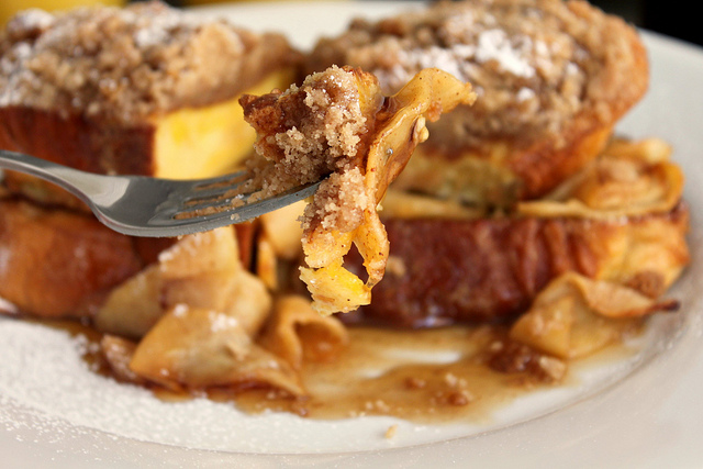 Challah French toast with warm apples and cinnamon crumble