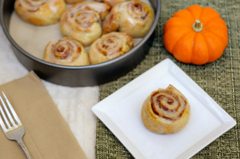 pumpkin pie cinnamon rolls with orange vanilla glaze