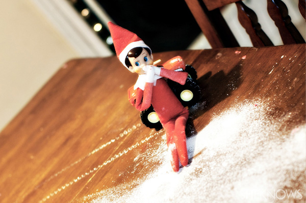 Elf on the Shelf idea 3: Elfie Rojo making snow angels