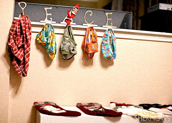 Elf on the Shelf idea 4: Elfie Rojo trading stocking for undergarments