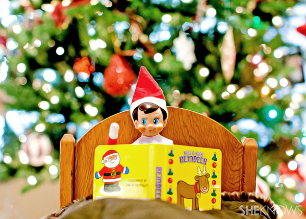 Elf on the Shelf idea 5: Elfie Rojo reading a book