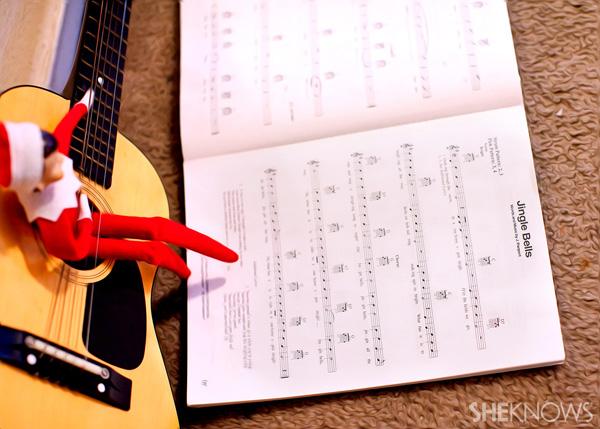 Elf on the Shelf idea 6: Elfie Rojo playing music