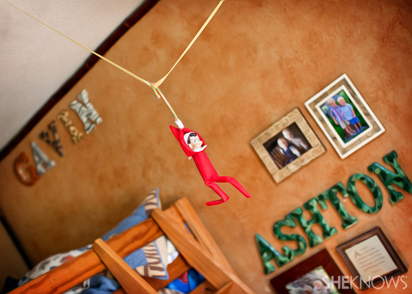 Elf on the Shelf idea 7: Elfie Rojo zip lining