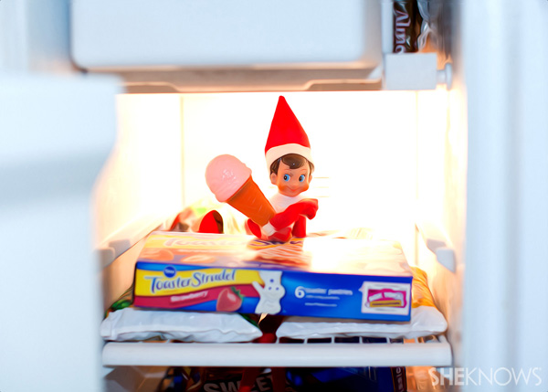 Elf on the Shelf idea 8: Elfie Rojo eating ice cream