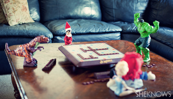 Elf on the Shelf idea 10: Elfie Rojo playing Scrabble