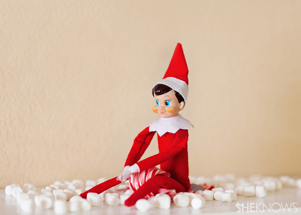 Elf on the Shelf idea 21: Elfie Rojo rides a candy cane sled