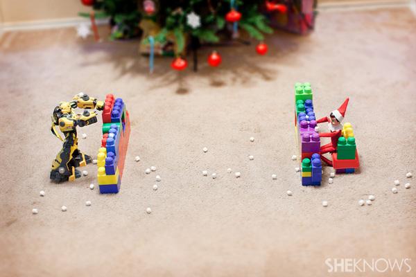 Elf on the Shelf idea 14: Elfie Rojo has a snowball fight