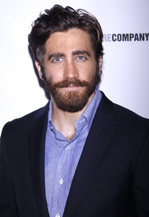 Jake Gyllenhaal holds hands with mystery girl