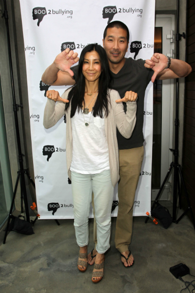 Pregnant Lisa Ling and husband