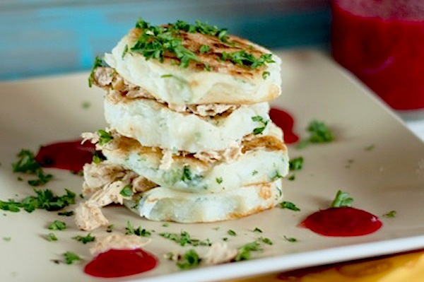 Mashed potato pancakes with turkey and cranberry syrup