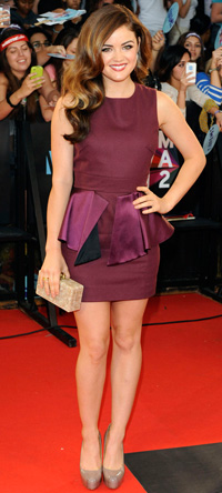 Lucy Hale wearing eplum dress