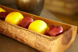 apples in a basket made of wood