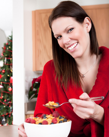Woman having breakfast on Christmas morning