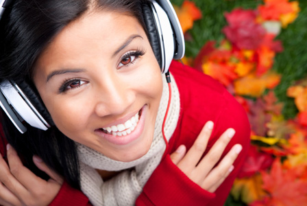 Woman listening to music in autumn