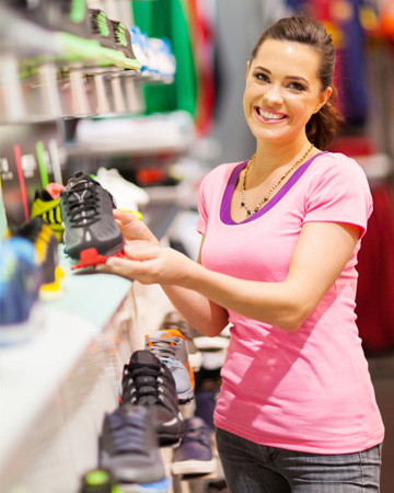 Woman shopping for athletic sneakers