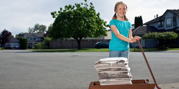 Girl delivering newspapers
