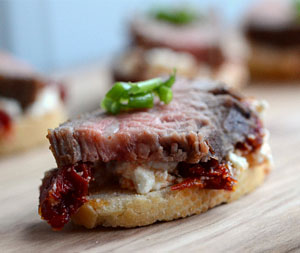 Spicy tomato goat cheese and steak crostini