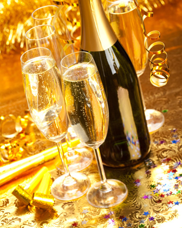 Champagne flute glasses with bottle on New Years Eve