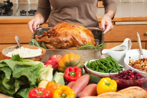 Christmas turkey surounded by vegetables