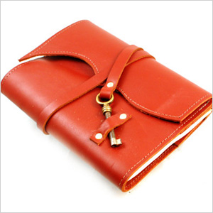 red orange leather notebook